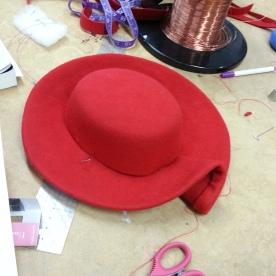 Hand-sewing crown to brim
